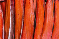 Close up view of lot fillet salted cold smoked red fish King Salmon