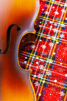 Photo of old violin on Christmas decoration.
