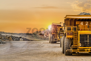 Dump Trucks transporting Platinum ore for processing