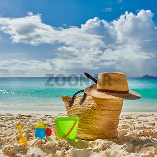 Beautiful beach with bag and toys at Seychelles