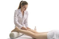 woman doing massage on foots of client