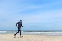 Senior man running at the beach