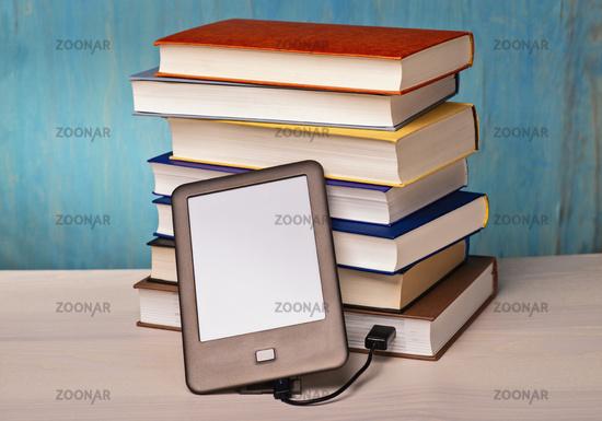 e-book reader and book stacks