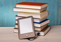 e-book reader and book stacks