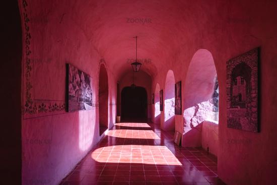 Corridor with arches of the former monestary Convent de San Bernardino de Siena in Valladolid Mexico