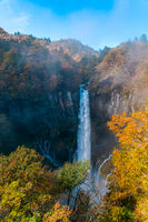 View of Kegon Waterfall at the cliff of colorful foliage of autumn season forest