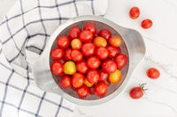Top view of of fresh cherry tomatoes in a strainer