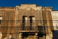 Abandoned facade of colonial house with stucco and balcony, Merida, Yucatan, Mexico