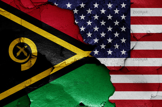 flags of Vanuatu and USA painted on cracked wall
