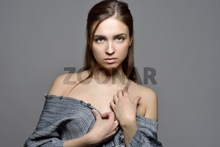 Portrait of the beautiful woman with naked shoulders.