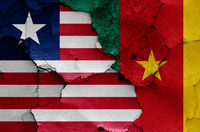 flags of Liberia and Cameroon painted on cracked wall