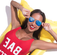 Sexy tanned brunette in sunglasses sunny shot