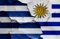 flags of Cerro Largo Department and Uruguay painted on cracked wall