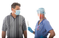 Healthcare professional holding a COVID-19 virus swab test for patient