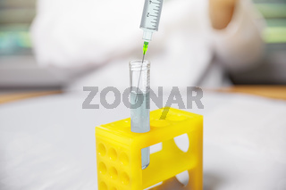 test tube syringe at laboratory