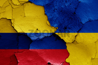 flags of Colombia and Ukraine painted on cracked wall