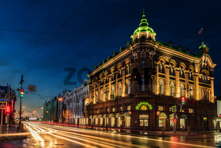 An old building in the central street of Tomsk on a summer night