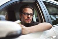 Close up side portrait of caucasian man driving car.