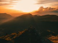 man silhouette stay on a mountain top in dolomites during sunset