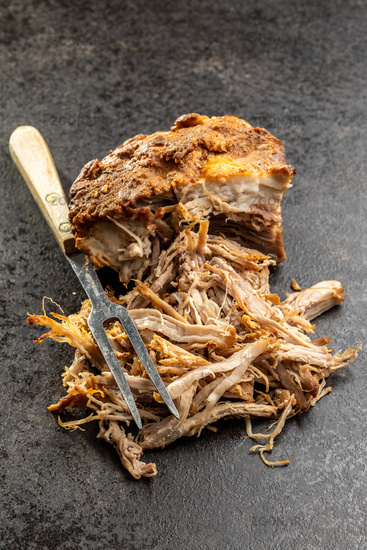Pulled pork meat with fork