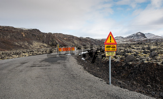Dangerous closed  road with warning signs in Iceland