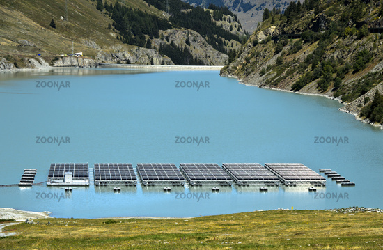 Solar panels of a solar power plant float on the mountain lake Lac des Toules