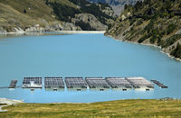 Solar panels from a solar power plant floating on the mountain lake Lac des Toules