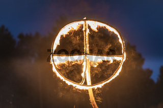 Burning sun cross at Kupala Night. Slavic holiday celebrated on the shortest night of the year, summer solstice