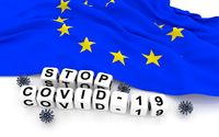 European Union flag and text stop covid-19.