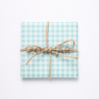 Green check pattern gift box isolated on white background
