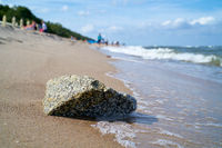 Stone on the beach of the Baltic Sea near Rewal in Poland