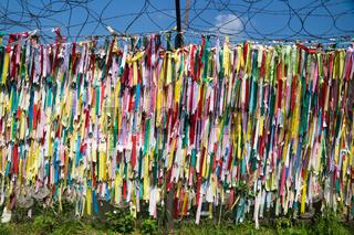 DMZ, Freedom bridge, Republic of Korea - September 8 2017: Colorful peace ribbons tied at a fence at the demilitarised zone DMZ at the freedom bridge, South Korea, Asia
