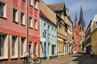 bitterfeld, germany - 19.06.2019 - street in the old town with town hall and antonius church