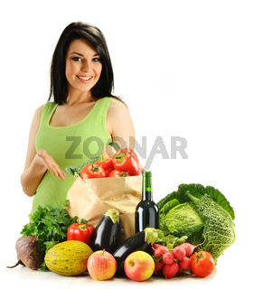 Young woman and groceries isolated on white