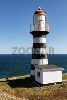 Petropavlovsk Lighthouse on coast of Pacific Ocean. Petropavlovsk City, Russian Far East