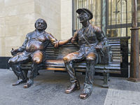 Bronze sculpture Postman and his friend chatting on a bench, Shavteli street, Tbilisi, Georgia