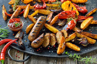 Vegan sausages with potato wedges