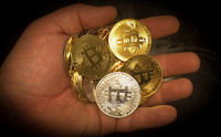 Closeup of physical bitcoin in a hand