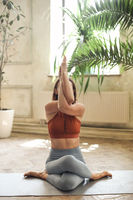 Slim woman doing yoga at home