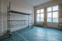 empty room during renovation with scaffolding - home refurnishment -