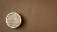 white chia seeds in a small ceramic bowl