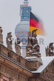 Berlin Politics - Winter, German Flag over the historic Zeughaus infront TV-Tower, german history