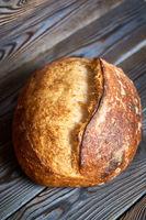 Homemade tartine bread on dark wooden table