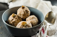 Energy Balls In Bowl With Spoon And Napkin