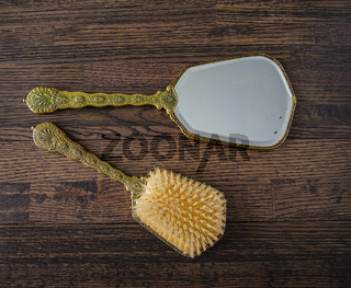 Vintage hand mirror and hair brush