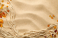 Sand Background With Ambers And Fishing Net