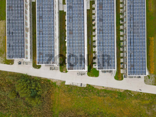 Top down view aerial of solar panels on urban houses home house hould renewable