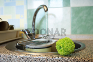 Plastic mesh scourer close to the sink