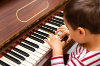 Litlle boy playing the piano