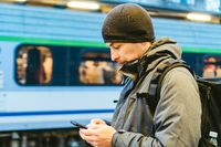Sopot Railway station. traveler waiting for transportation. Travel concept. Man at the train station. Portrait Caucasian Male In Railway Train Station. Handsome commuter while waiting for his train